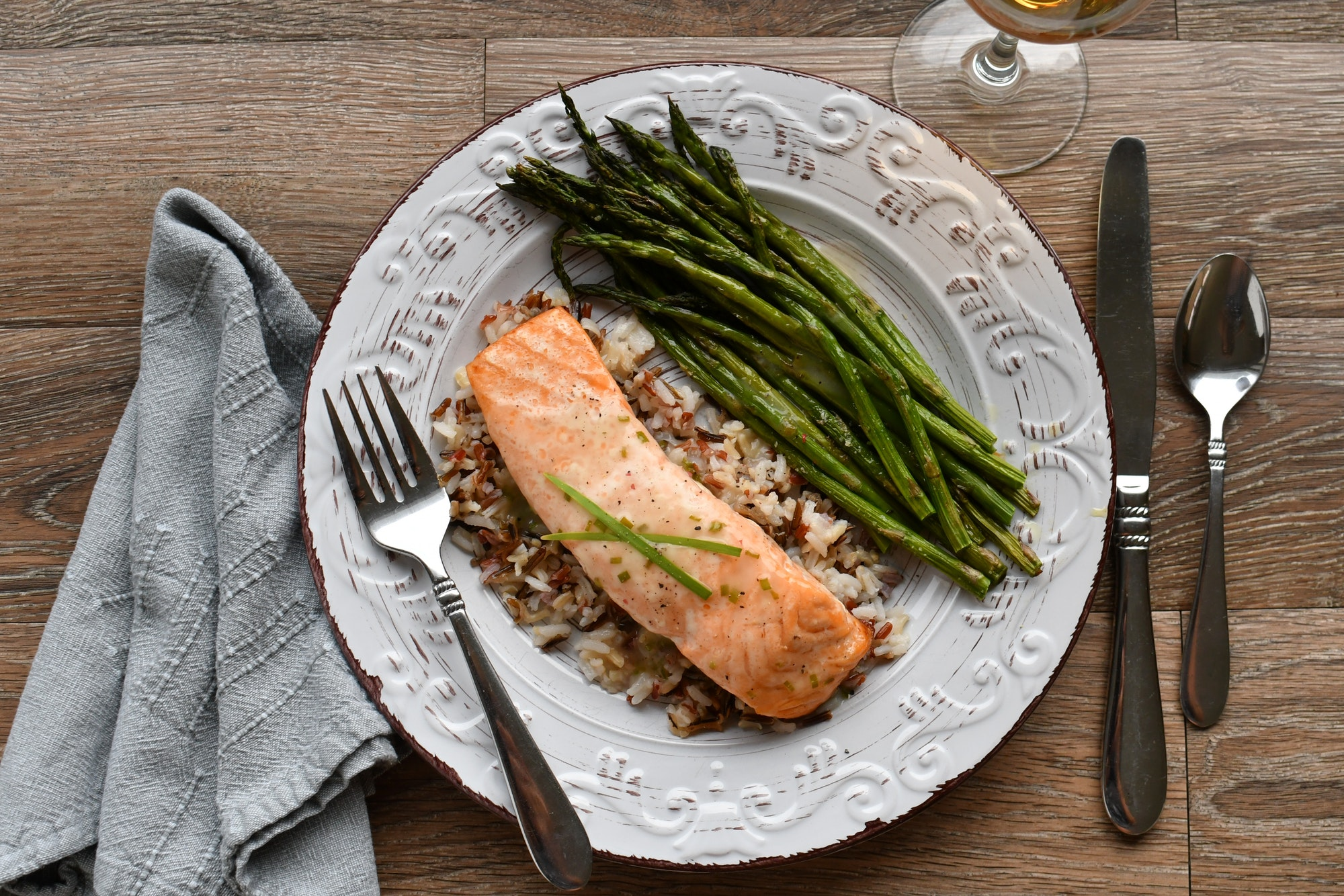 Roasted Salmon with wild rice medley and roasted asparagus topped with a white wine chive sauce