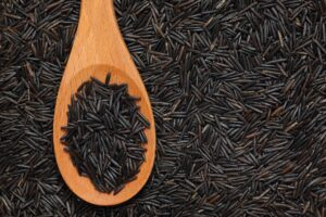 Wild rice in a wooden spoon